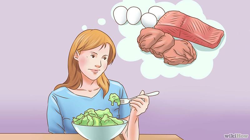 девушка ест салат и мечтает о мясе